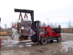60,000 lb Printing press being hoisted by our 80,000 lb Rigger lift truck and 50 ton boom